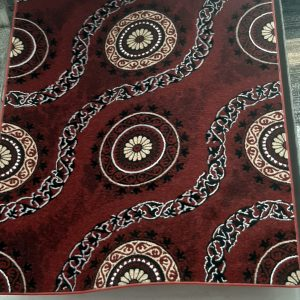 alfombra circulo con rayas curvas